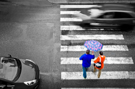 32498479 - pedestrian crossing with cars in the rain